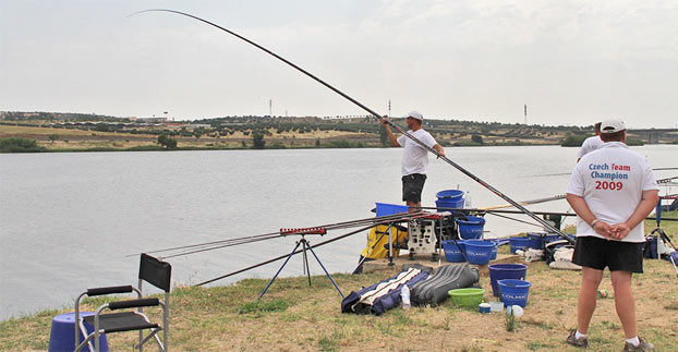 Above and below: Eleven and twelve metres of pole stuck up in the air, while playing and landing fish, was a common sight in this years Championship.