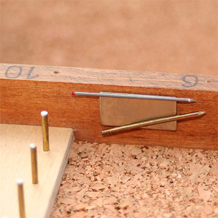 Measuring pins are retained inside the box, attached to a magnetic strip, so they will not get lost.
